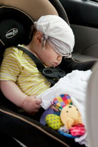 baby sleeping in a car seat.